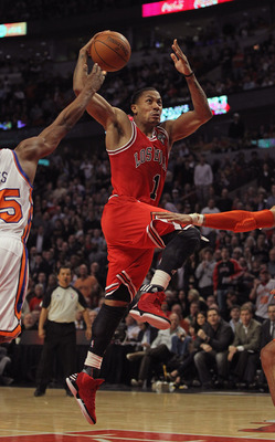 CHICAGO, IL - MARCH 12:  Derrick Rose #1 of the Chicago Bulls goes up for a dunk against the New York Knicks on his way to a game-high 32 points at the United Center on March 12, 2012 in Chicago, Illinois. The Bulls defeated the Knicks 104-99. NOTE TO USE