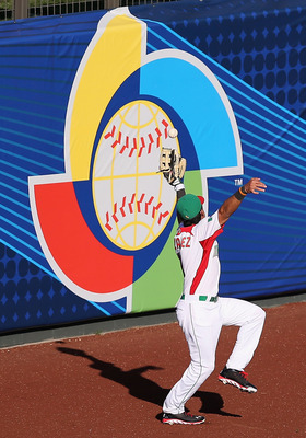 Gonzalez dropped a ball in left that allowed the winning run to score for Italy.