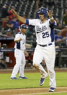 Colabello celebrates as he scores in the eighth inning of Italy's match up with Canada. (Photo courtesy of TwinCities.com)