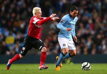 Carlos Tevez scored a hat-trick for Manchester City in the FA Cup win over Barnsley.