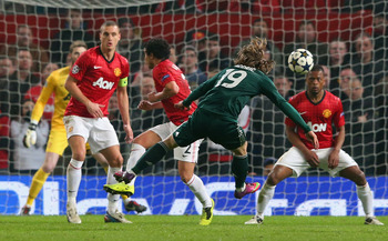 Luka Modric strikes for Real Madrid against Manchester United in the Champions League.
