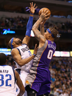 DALLAS, TX - JANUARY 27:  Michael Beasley #0 of the Phoenix Suns takes a shot against Vince Carter #25 of the Dallas Mavericks at American Airlines Center on January 27, 2013 in Dallas, Texas.   NOTE TO USER: User expressly acknowledges and agrees that, b