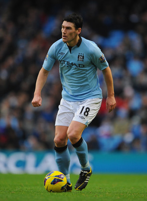 MANCHESTER, ENGLAND - JANUARY 01:  Gareth Barry of Manchester City in action during the Barclays Premier League match between Manchester City and Stoke City at the Etihad Stadium on January 1, 2013 in Manchester, England.  (Photo by Michael Regan/Getty Im