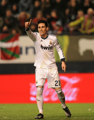 PAMPLONA, SPAIN - JANUARY 12: Jose Maria Callejon of Real Madrid signals to the linesman after he was called offside during the La Liga match between Osasuna and Real Madrid at estadio Reino de Navarra on January 12, 2013 in Pamplona, Spain.  (Photo by De