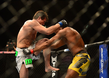 Chael Sonnen attempts to knee Anderson Silva at UFC 148.