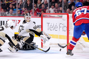 Montreal Canadien Max Pacioretty scores against Tomas Vokoun of the Pittsburgh Penguins.