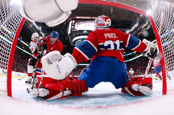 Carey Price attempts a save on Daniel Alfredsson of the Ottawa Senators.