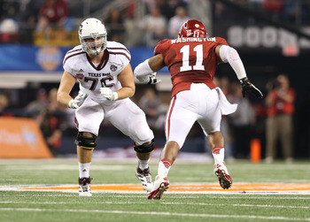 Jan 4, 2013; Arlington, TX, USA; Texas A&M Aggies tackle Luke Joeckel (76) looks to make a block against the Oklahoma Sooners defensive end R. J. Washington (11) during the Cotton Bowl at Cowboys Stadium.  Texas A&M beat Oklahoma 41-13. Mandatory Credit:
