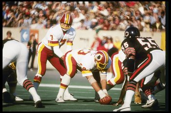 Joe Theismann getting ready to snap the ball against Chicago.