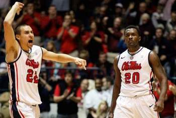 Ole Miss players Marshall Henderson (22) and Nick Williams (20). ROGELIO V. SOLIS / AP