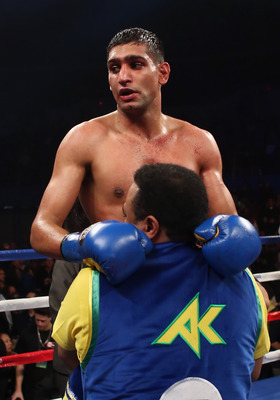 Amir Khan celebrating victory.