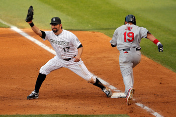 DENVER, CO - AUGUST 02:  First baseman Todd Helton #17 of the Colorado Rockies gets a put out on Jon Jay #19 of the St. Louis Cardinals at Coors Field on August 2, 2012 in Denver, Colorado. The Rockies defeated the Cardinals 8-2.  (Photo by Doug Pensinger