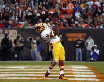 "Redskins RB Alfred Morris celebrates his touchdown with a ""home run""."