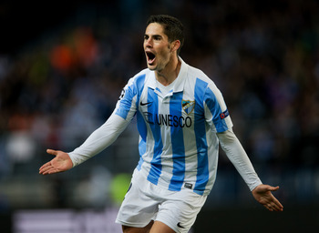 MALAGA, SPAIN - MARCH 13:  Isco of Malaga CF celebrates scoring his sides opening goal during the UEFA Champions League Round of 16 second leg match between Malaga CF and FC Porto at La Rosaleda Stadium on March 13, 2013 in Malaga, Spain.  (Photo by Jaspe