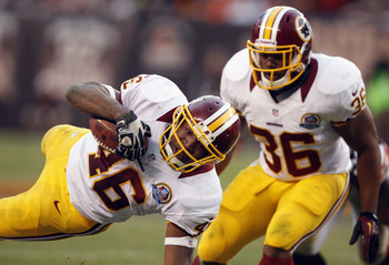 Darrel Young (36) opened holes for Alfred Morris all season long and was awarded with a three-year deal.