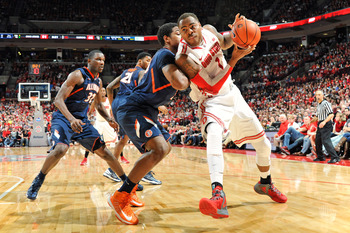 COLUMBUS, OH - MARCH 10:  Deshaun Thomas #1 of the Ohio State Buckeyes attempts to drive the baseline against Myke Henry #20 of the Illinois Fighting Illini in the second half on March 10, 2013 at Value City Arena in Columbus, Ohio. Ohio State defeated Il