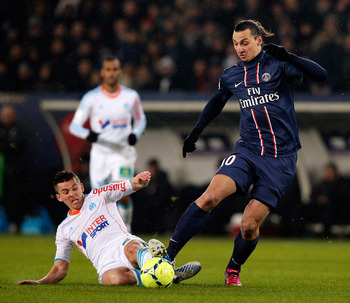 PARIS, FRANCE - FEBRUARY 24:  Zlatan Ibrahimovic of PSG and Joey Barton of Marseille battle for the ball during the Ligue 1 match between Paris Saint-Germain FC and Olympique de Marseille at Parc des Princes on February 24, 2013 in Paris, France.  (Photo