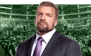 Triple H's clean cut business look is much different than his long-haired persona in DX. Photo Courtesy of WWE.com