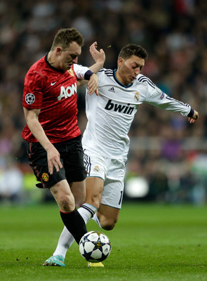 Jones and Mesut Ozil clash at the Bernabéu.