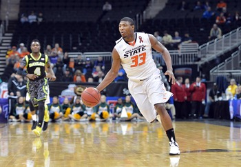 Mar 14, 2013; Kansas City, MO, USA; Oklahoma State Cowboys guard Marcus Smart (33) brings the ball up the court against the Baylor Bears in the second half during the second round of the Big 12 tournament at the Sprint Center. Oklahoma State defeated Bayl
