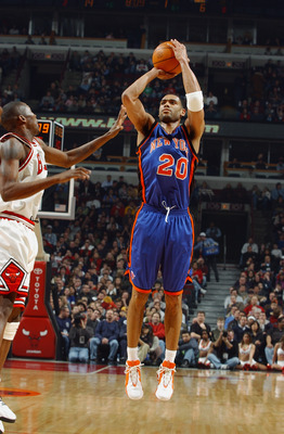 CHICAGO - JANUARY 17:  Allan Houston #20 of the New York Knicks shoots over Jamal Crawford #1 of the Chicago Bulls during the game on January 17, 2004 at the United Center in Chicago, Illinois. The Knicks won 101-96. NOTE TO USER: User expressly acknowled