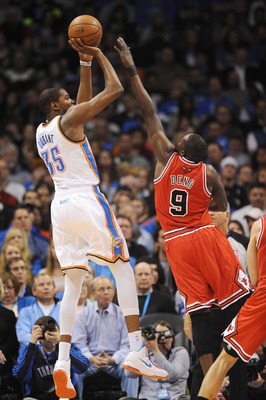 Feb 24, 2013; Oklahoma City, OK, USA; Oklahoma City Thunder forward Kevin Durant (35) attempts a shot against Chicago Bulls forward Luol Deng (9) during the second half at Chesapeake Energy Arena. Mandatory Credit: Mark D. Smith-USA TODAY Sports