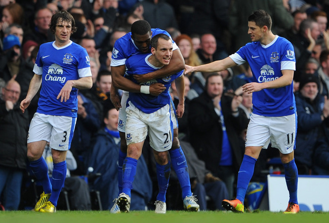LIVERPOOL, ENGLAND - MARCH 16:  Leon Osman of Everton celebrates scoring the opening goal with his team-mates during the Barclays Premier League match between Everton and Manchester City at Goodison Park on March 16, 2013 in Liverpool, England.  (Photo by