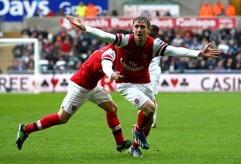 Nacho Monreal celebrates his opening goal for Arsenal in the 2-0 win at Swansea City.