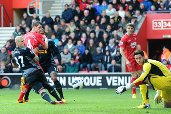 Morgan Schneiderlin opens the scoring for Southampton against Liverpool.