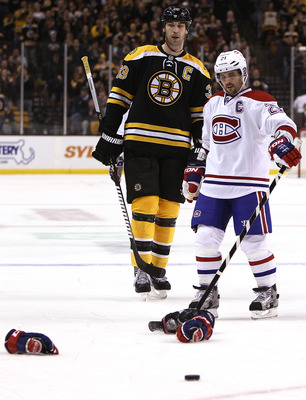 Brian Gionta of the Montreal Canadiens and Zdeno Chara of the Boston Bruins.