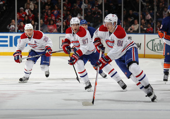 Lars Eller of the Montreal Canadiens leads an offensive rush.