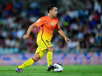 Xavi's passes are efficient, moving play along yet minimizing risk.