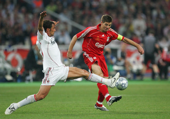 Paolo Maldini, shown here tackling Steven Gerrard in the 2007 Champions League final, was one of world football's best defenders for parts of three decades.