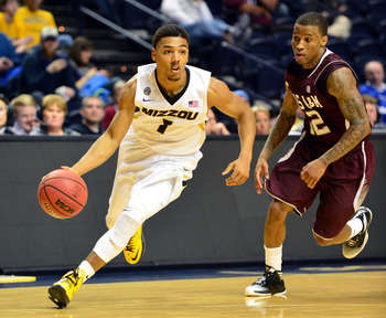 Mar 14, 2013; Nashville, TN, USA; Missouri Tigers guard Phil Pressey (1) drives against the Texas A&M Aggies during the second round of the SEC tournament at Bridgestone Arena. The Tigers beat the Aggies 62-50. Mandatory Credit: Don McPeak-USA TODAY Sport