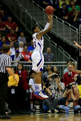 KANSAS CITY, MO - MARCH 15: Ben McLemore #23 of the Kansas Jayhawks shoots a three-point shot against the Iowa State Cyclones in the first half during the Semifinals of the Big 12 basketball tournament at the Sprint Center on March 15, 2013 in Kansas City