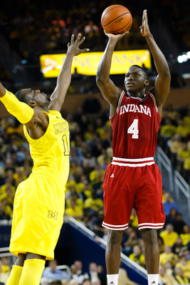 March 10, 2013; Ann Arbor, MI, USA; Indiana Hoosiers guard Victor Oladipo (4) shoots the ball over Michigan Wolverines guard Tim Hardaway Jr. (10) at Crisler Center. Mandatory Credit: Rick Osentoski-USA TODAY Sports