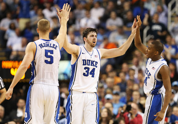 Duke players Mason Plumlee (5), Ryan Kelly (34) and Rasheed Sulaimon (14).