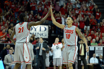 New Mexico's Tony Snell (21) and Kendall Williams (10).