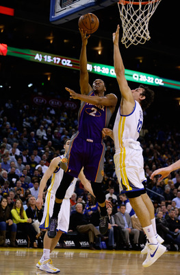 OAKLAND, CA - FEBRUARY 20:  Wesley Johnson #2 of the Phoenix Suns of the Phoenix Suns shoots over Andrew Bogut #12 of the Golden State Warriors at Oracle Arena on February 20, 2013 in Oakland, California. NOTE TO USER: User expressly acknowledges and agre