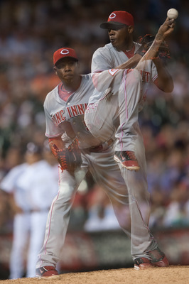 DENVER, CO - JULY 28:  An in-camera multiple exposure image of Aroldis Chapman #54 of the Cincinnati Reds as he begins a windup and makes a pickoff attempt by throwing to first base in the ninth inning of a game against the Colorado Rockies at Coors Field