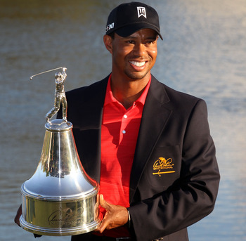 Tiger Woods with his seventh Arnold Palmer Invitational trophy.