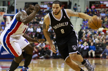March 18, 2013; Auburn Hills, MI, USA; Brooklyn Nets point guard Deron Williams (8) drives against Detroit Pistons point guard Will Bynum (12) in the first quarter at The Palace. Mandatory Credit: Rick Osentoski-USA TODAY Sports