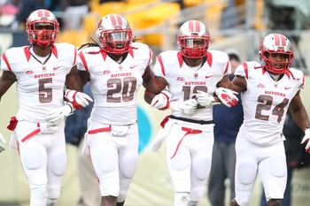 November 24, 2012; Pittsburgh, PA, USA; Rutgers Scarlet Knights wide receiver Tim Wright (5) and linebacker Khaseem Greene (20) and defensive back Marcus Cooper (12) and defensive back Mason Robinson (24) take the field to begin the game against the Pitts