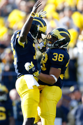 ANN ARBOR, MI - NOVEMBER 17: Devin Gardner #12 of the Michigan Wolverines celebrates a first quarter touchdown with Thomas Rawls #38 while playing the Iowa Hawkeyes at Michigan Stadium on November 17, 2012 in Ann Arbor, Michigan. (Photo by Gregory Shamus/