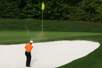 It's not an impossible shot from the front bunker on the fourth hole, but it's not easy.