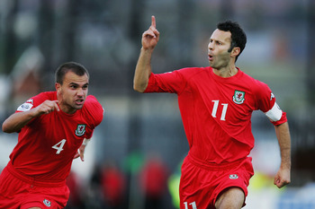 BELFAST, NORTHERN IRELAND - OCTOBER 8:  Ryan Giggs of Wales celebrates scoring their third goal during the FIFA World Cup Qualifier Group Six match between Northern Ireland and Wales at Windsor Park on October 8, 2005 in Belfast, Northern Ireland.  (Photo