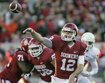 NORMAN, OK - NOVEMBER 24:  Quarterback Landry Jones #12 of the Oklahoma Sooners throws against the Oklahoma State Cowboys November 24, 2012 at Gaylord Family-Oklahoma Memorial Stadium in Norman, Oklahoma. (Photo by Brett Deering/Getty Images)