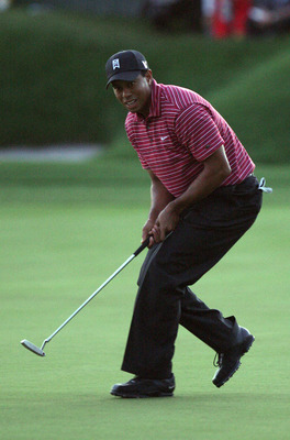Tiger Woods watches the winning putt in 2009