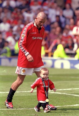 Brooklyn Beckham begins his football journey alongside his dad during the 1999-2000 Premier League title celebrations.