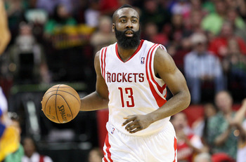 Mar 17, 2013; Houston, TX, USA; Houston Rockets shooting guard James Harden (13) brings the ball up the court during the fourth quarter against the Golden State Warriors at Toyota Center. Mandatory Credit: Troy Taormina-USA TODAY Sports